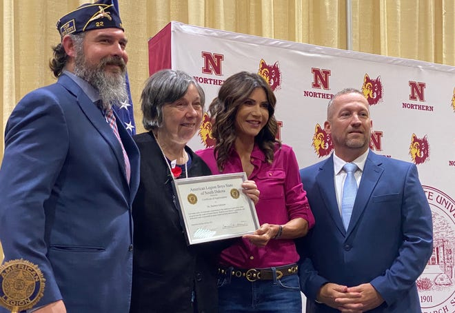 Gov. Kristi Noem presented Barbara Johnson of Aberdeen, a certificate of appreciation from the American Legion Boys State in recognition of the Johnson family contributions to the event that has been at Northern State University for the past 78 years. Pictured, from left, are Boys State Director Christopher Van Delist, Johnson, Gov. Noem and Boys State Director of Counselors Cory Raberberg