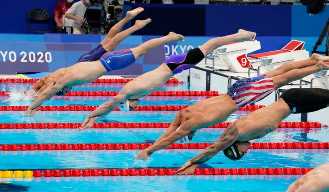 Michael Andrew (USA) dives into the pool in the men's 50-meter freestyle heats Friday during the Tokyo 2020 Olympic Summer Games at Tokyo Aquatics Centre. Mandatory Credit: Rob Schumacher-USA TODAY Sports