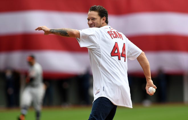 Former Red Sox pitcher Jake Peavy delivers a ceremonial first pitch in 2019 at Fenway Park.