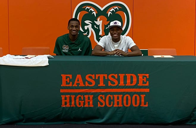 """Omar Brown and Jarveil """"Jarvy"""" Gainey at a college signing ceremony Friday at Eastside High School."""