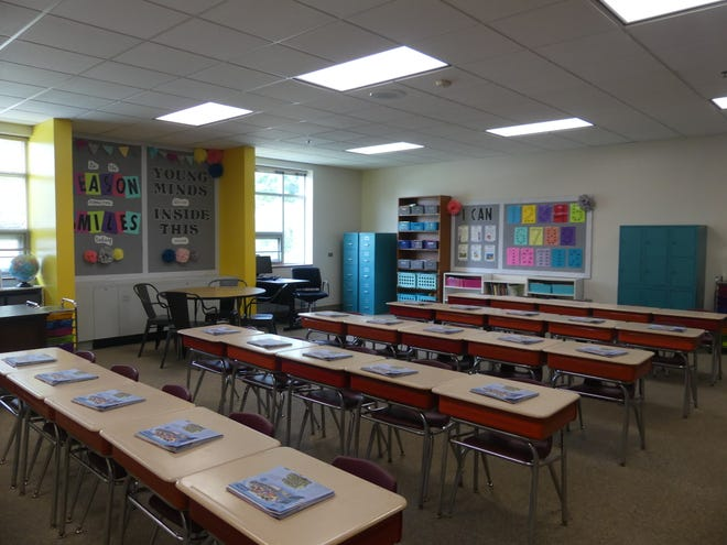 Teachers have begun setting up their classrooms inside the school.
