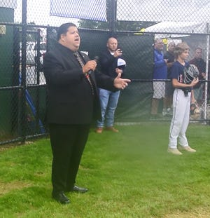Boston Bruins' Todd Angilly is shown singing the National Anthemduring the opening ceremony of the State Little League finals at Gloucester's Stagefort Park on July 29.