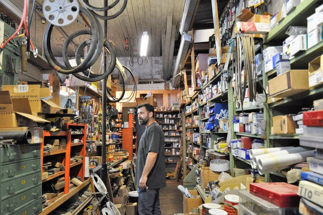 James Gilbert and his wife, Jessica, bought the former White Auto and Home on July 1 and renamed it Gilbert & Son Hardware. Inventorying merchandise remained a task Thursday between helping customers.
