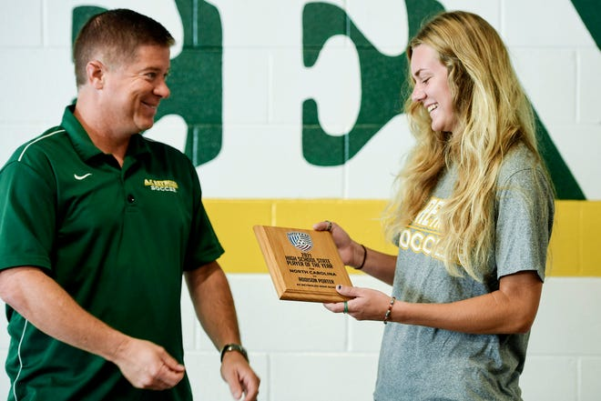Addison Porter is given a 2021 High School State Player of the Year award by soccer coach Patrick Gladys at Reynolds July 29, 2021.
