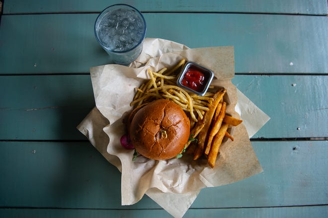 Campfire Grill's counselor burger with beer battered french fries and rosemary fries.