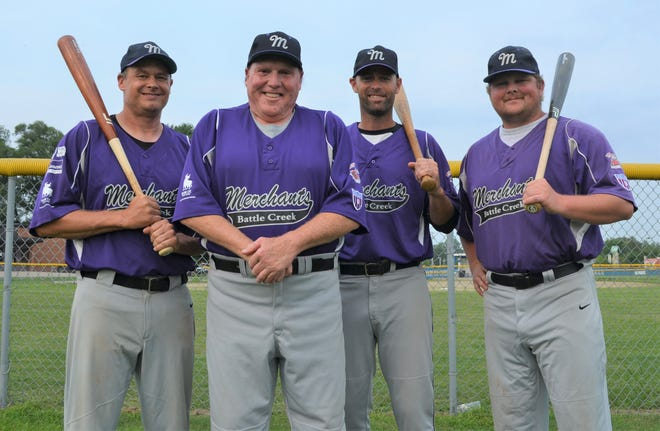 Battle Creek Merchants manager Jack McCulley, center, is joined by veteran players, from left, Dave Larson, Reggie Walters and Cam Bortell. The Merchants will be playing in the upcoming NABF World Series at Bailey Park, starting Wednesday.