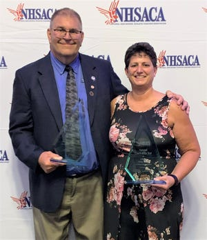 St. Philip volleyball coach Vicky Groat, right, and St. Philip High School alum Fred Smith each earned national honors on Thursday from the National High School Athletic Coaches Association. Groat was named National Coach of the Year for volleyball and Smith was named National Athletic Director of the Year.