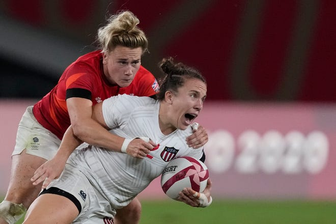 Kristi Kirshe of the United States, right, is brought down by Britain's Megan Jones in their women's rugby sevens quarterfinal match at the 2020 Summer Olympics, Friday, July 30, 2021 in Tokyo, Japan. (AP Photo/Shuji Kajiyama)