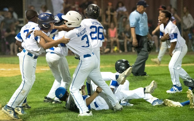 Members of the Teaneck Little League team celebrate after defeating Haddonfield, 6-5, in an opening round game of the U-12 Little League tournament played in Cherry Hill on Thursday, July 29, 2021.
