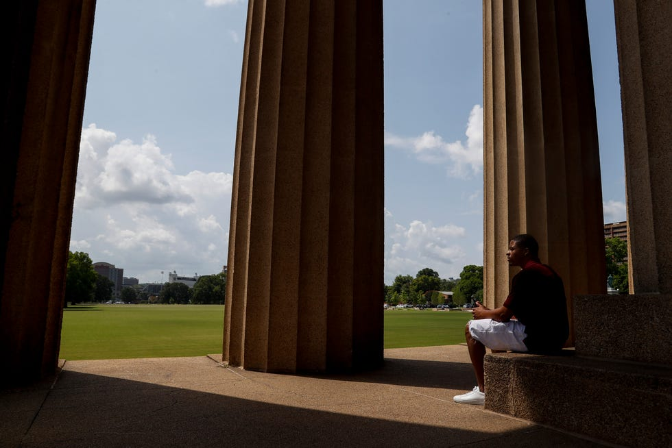 Chris Young, a Clarksville resident who was pardoned by former President Donald Trump, poses for a portrait at The Parthenon at Centennial Park in Nashville, Tenn., on Thursday, July 15, 2021. Young will mark his sixth month out of prison in the summer of 2021 and since his pardon has made efforts to start an organization that will help those who had been wrongly imprisoned through the legal system.