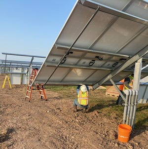 Crews install solar panels at the first Alliant Energy Community Solar site located in Fond du Lac, along the south side of state Highway 151, west of the intersection with Hickory Road.