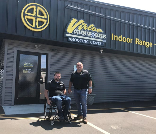Scott Virlee, left, owner and gunsmith of Virlee Gunworks Shooting Center, is joined by business partner Steve Estes outside the new Sturgeon Bay store, Virlee's second location in Northeast Wisconsin, the day before its July 31 grand opening.