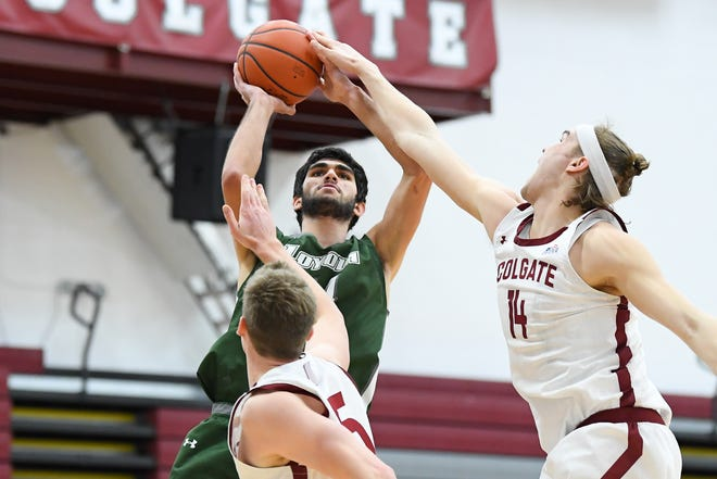 Mar 14, 2021; Hamilton, New York, USA; Loyola (Md) Greyhounds forward Santi Aldama (34) shoots the ball while defended by Colgate Raiders forward Keegan Records (14) during the first half of the 2021 Patriot League Conference Championship game at Cotterell Court.