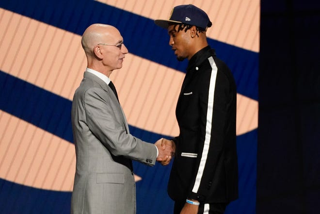 Ziaire Williams greets NBA Commissioner Adam Silver after being selected tenth overall by the New Orleans Pelicans during the NBA basketball draft, a pick that would go to the Memphis Grizzlies.