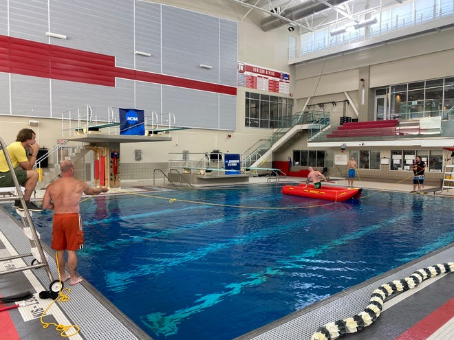 Granville Township Firefighters train with the new rescue boat inside the aquatic facilities at Denison University.
