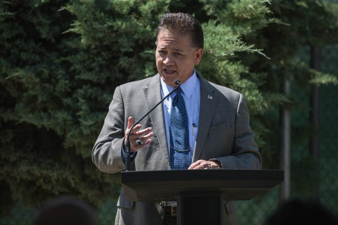 Las Cruces Mayor Ken Miyagishima speaks at the unveiling of a memorial plaque in honor of former City Councilor Olga Pedroza at Lions Park in Las Cruces on Friday, July 30, 2021.