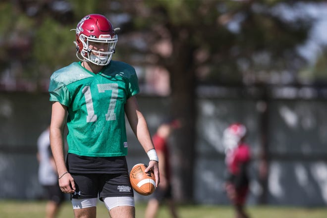 Quarterback Weston Eget (17) works on drills at the first practice on NMSU campus in Las Cruces on Friday, July 30, 2021.