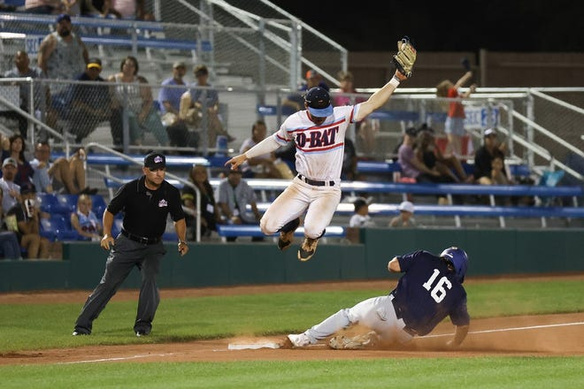 D-BAT United's Gavin Glasgow attempts to tag out Enid Majors' Ty Hammack at third base as he slides in at the top of the fifth inning on Thursday, July 29, at Connie Mack World Series play at Ricketts Park.