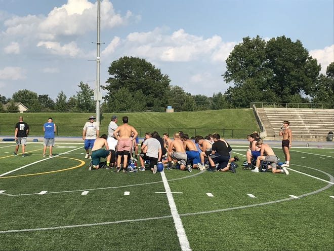 Lakeland first-year head coach James Calhoun speaks to his team after a summer workout session.