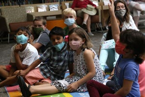 Nevada Governor Steve Sisolak reads a book to masked up children in the Downtown Reno Library on July 30, 2021.