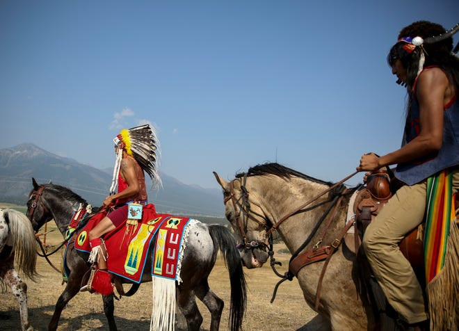 """Members of the Nez Perce Tribe ride on Am'sáaxpa or """"the place of boulders,"""" for a land blessing ceremony on Thursday."""