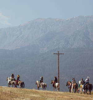 """Members of the Nez Perce Tribe ride to Am'sáaxpa or """"the place of boulders,"""" for a land blessing ceremony on Thursday."""