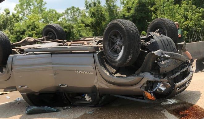Vehicle overturned on Market Street.