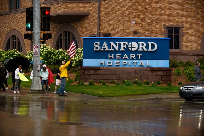 Protesters gathered outside Sanford Hospital to protest the healthcare company's vaccination policy.