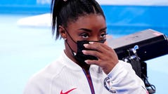 Simone Biles (USA) looks on after pulling out of the women's team final during the Tokyo 2020 Olympic Summer Games at Ariake Gymnastics Centre.