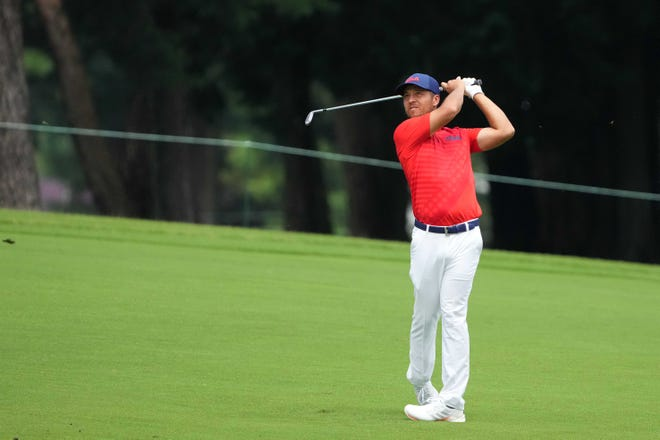 Xander Schauffele of the USA hits on the third hole during round two of the men's individual stroke play of the Tokyo Olympics, held Friday at Kasumigaseki Country Club.