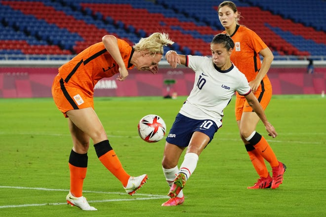 Team United States forward Carli Lloyd (10) and Team Netherlands defender Stefanie van der Gragt (3) battle for the ball during the first half in a women's quarterfinals match during the Tokyo 2020 Olympic Summer Games at International Stadium Yokohama on July 30, 2021. Mandatory Credit: Jack Gruber-USA TODAY Sports ORG XMIT: OLY-454636 ORIG FILE ID:  20210730_jcd_usa_046.jpg