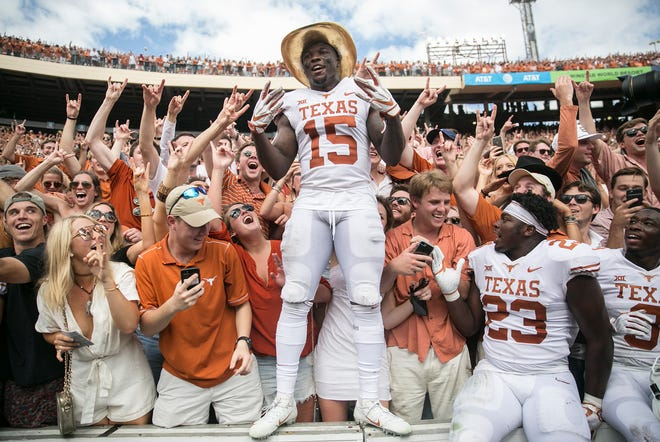 """Texas' Chris Brown celebrates with fans at the Cotton Bowl after the 2018 win over Oklahoma. ESPN analyst Paul Finebaum, on this week's """"On Second Thought"""" podcast, says he is pumped about Texas' and Oklahoma's jump to the SEC. """"I want it in four weeks,"""" he said."""