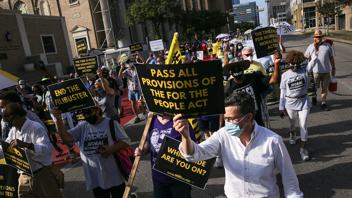 See hundreds protest new Texas voting bill on final day of a 27-mile march to the Capitol