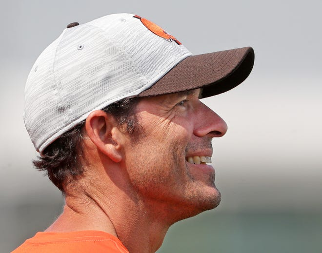 Cleveland Browns chief strategy officer Paul DePodesta watches the team practice during NFL football training camp, Saturday, July 31, 2021, in Berea, Ohio.