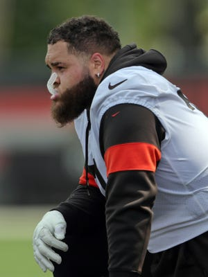 Cleveland Browns tackle Jedrick Wills Jr. takes a break on the sideline during NFL football training camp, Saturday, July 31, 2021, in Berea, Ohio.