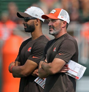Cleveland Browns GM Andrew Berry, left, and head coach Kevin Stefanski watch the team practice during NFL football training camp, Saturday, July 31, 2021, in Berea, Ohio.