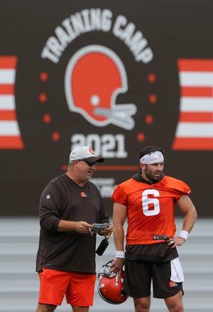 Browns offensive coordinator Alex Van Pelt, left, chats with quarterback Baker Mayfield during training camp. [Jeff Lange/Beacon Journal]
