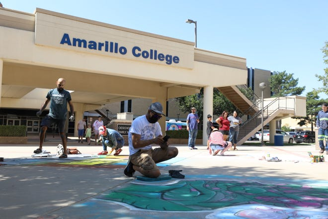 Individuals participate in Saturday's Chalk It Up festivities at the Washington Street campus of Amarillo College.