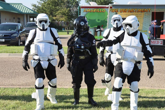 Star Wars Stormtroopers with the 501st Legion West Texas Squadron roam the aisles of the Amarillo Library's AMA-Con outside at the Southwest Amarillo Public Library Saturday.