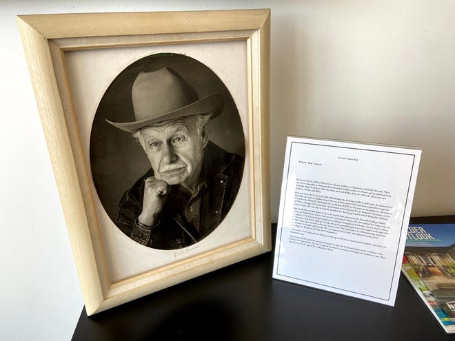 """A portrait memorial of Willard """"Bud"""" Alward sits inside Adobe Wall Stoneworks during the Meals on Wheels 50th anniversary celebration July 30. Pieces of his artwork were donated with funds going towards Meals on Wheels."""