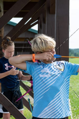 Campers at Deerassic Park have the opportunity to try their hand at various activities, including archery at the day camps offered.