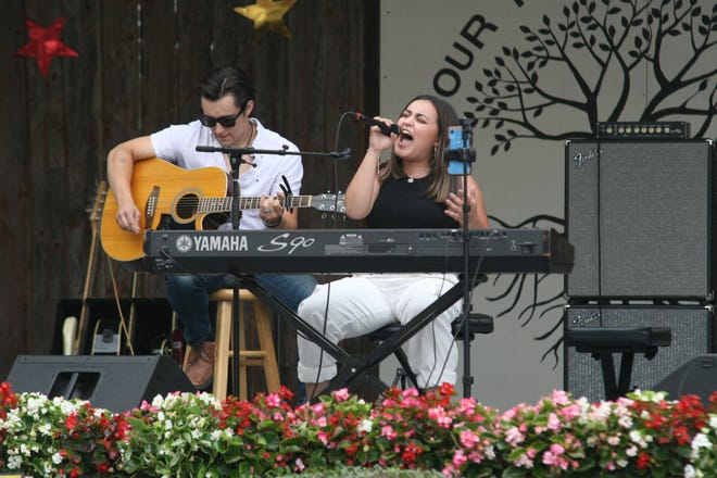 Singer Rio Doyle of Adrian sings while her brother, Tre Doyle, plays guitar Friday during her performance at the Lenawee County Fair bandshell.