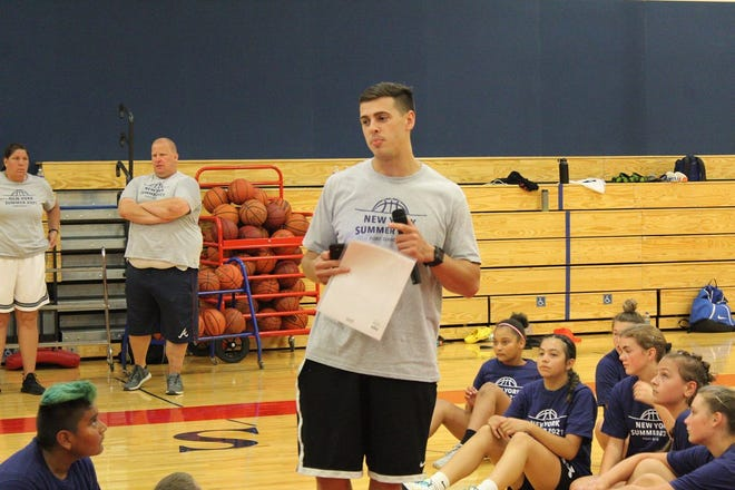 PGU Organizer Reed Warner talks to the players at the end of a session on Monday afternoon at Hornell High School.