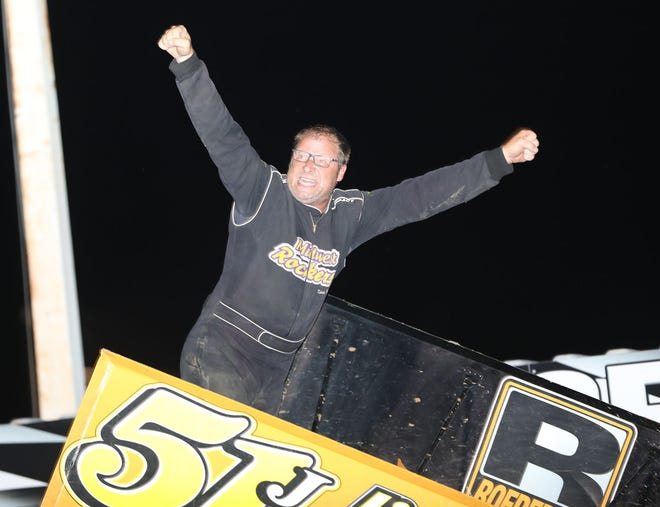 Ryan Jamison of Mediapolis celebrates after winning the 20-lap 305 sprint car feature race Friday night at 34 Raceway.