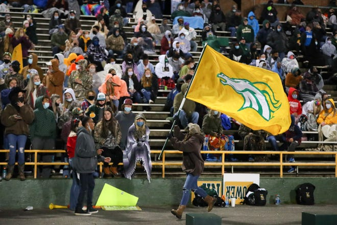 Crest fans celebrate following a touchdown last spring against rival Burns.