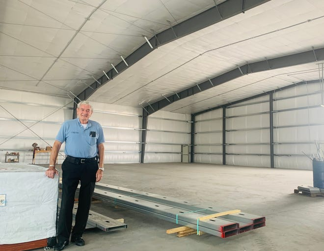 Harrel Timmons, president of the National Stearman Foundation Board, stands inside the 100,000 square foot hangar that will serve as the International Stearman Community Center. The 100,000-square foot hangar is constructed, but much of the interior work is yet to be completed.