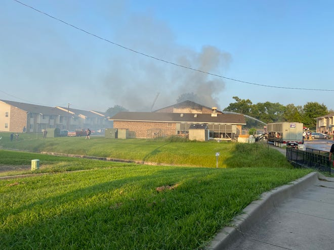Local crews work a structure fire at Hilltop Village Apartments in Sherman on July 30.