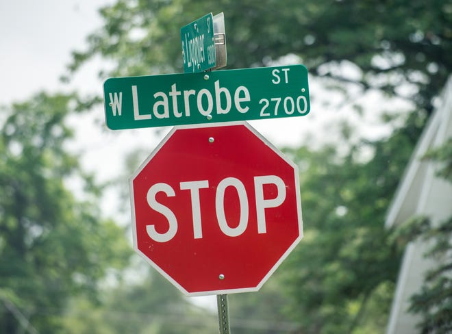 A street sign marks the 2700 block of West Latrobe Street in South Peoria. A body was found in the yard of a house on the block on Saturday morning.