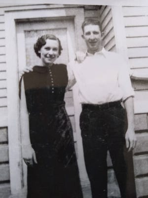 Emma and Ray Marshall, owners of Trio Cab in Monroe, outside their home, circa 1940s. The Marshall family, which also included daughter Marie, Marie's brother Ray Jr. and Marie's son Tom Weisbecker, operated several businesses in Monroe.