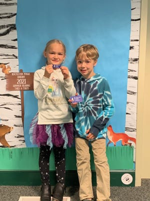 Annabelle shows off her new library card that she recently got while visiting the Rochester Public Library with her brother Keegan. Children 5 and up can get their own library card if they are a Rochester resident or attend Rochester Public Schools.